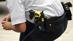 Policeman with taser